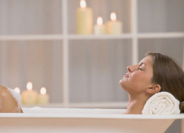 Woman relaxing in soaking tub